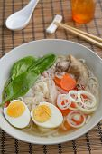 stock photo of duck egg blue  - Duck soup with rice pasta and vegetables - JPG