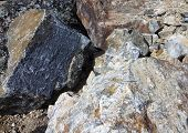image of feldspar  - Photo of a pile of granite stones close - JPG