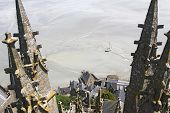 stock photo of michel  - View from the tower of the abbey Mountain Saint Michel stranded boat at low tide - JPG