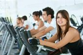 picture of male female  - Group of gym people exercising on cardio machines - JPG