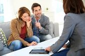 stock photo of real  - Couple meeting financial adviser for real estate project - JPG