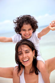 foto of smiley face  - mother and son portrait having fun outdoors - JPG
