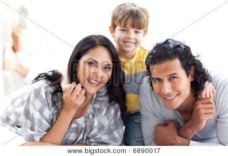 Portrait Of A Loving Family Lying On The Floor