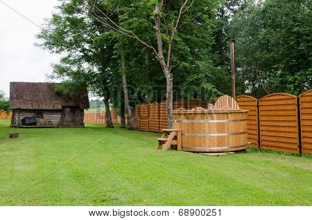 Wooden Hot Tub Water Rural Yard. Outdoor Pleasure.
