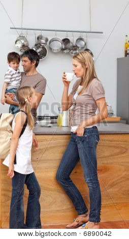 Family Talking In The Kitchen Before School