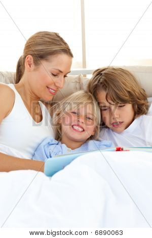 Pretty Mother And Her Children Reading Book