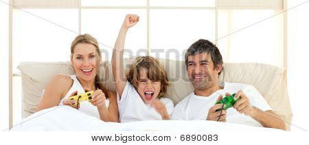 Smiling Little Boy Playing Video Game With His Family