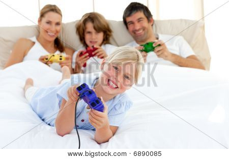 Little Blond Girl Playing Video Game With Her Family