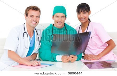 Smiling Medical Team Looking At X-ray