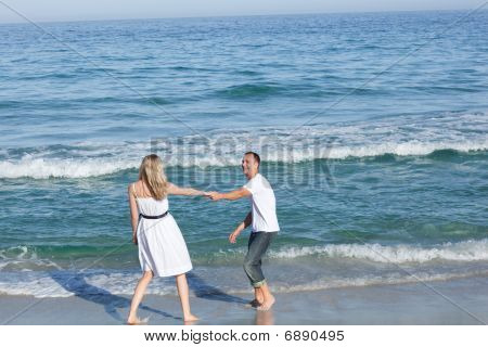 Affectionate Couple Walking At The Seaside