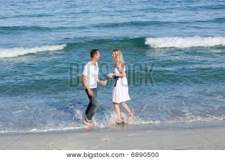 Enamoured Couple Walking At The Seaside