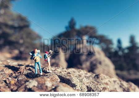 Miniature Hikers With Backpacks