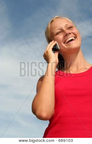 Happy Young Woman Using A Mobile Phone
