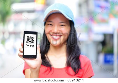 young asian woman hold blank smart phone on shopping street