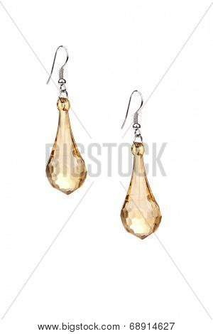 Pair of golden earrings isolated on white background