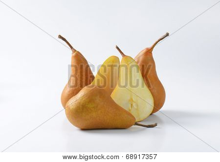 whole and halved pears isolated