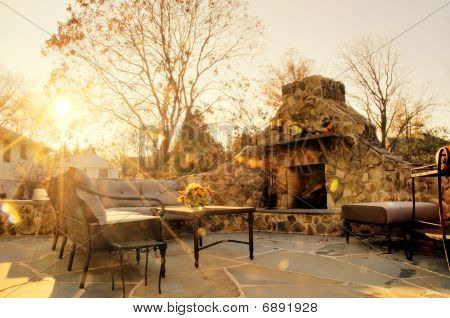 Sunlit Patio With Stone Fireplace