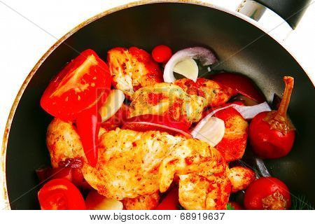 chicken brisket slices on black teflon pan