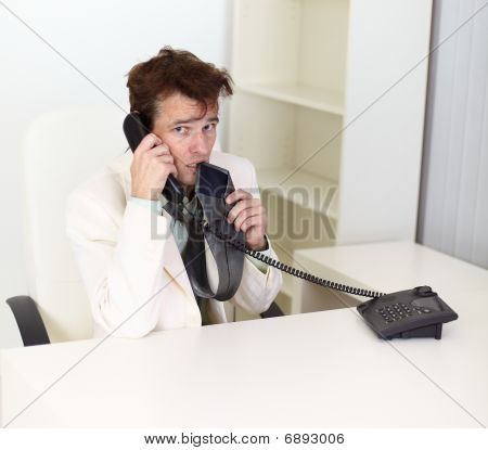 Disheveled Businessman Talking On Phone Very Excited