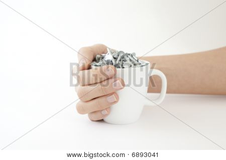 Woman Cradles A Cup Of Nails In A Coffee Cup
