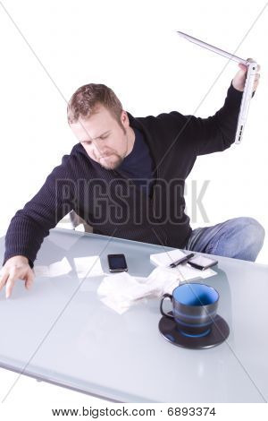 Frustrated Young Casual Businessman Working At His Desk