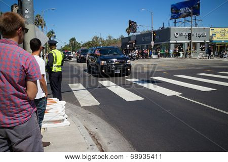 LOS ANGELES - July 23, 2014: President Barack Obama's motorcade crossing corner of 3rd Street and La Brea Avenue during presidential visit to LA.