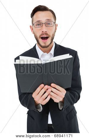 Young preacher reading from bible on white background