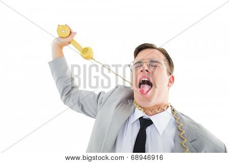 Geeky businessman being strangled by phone cord on white background