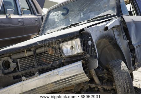 Damaged car in junkyard