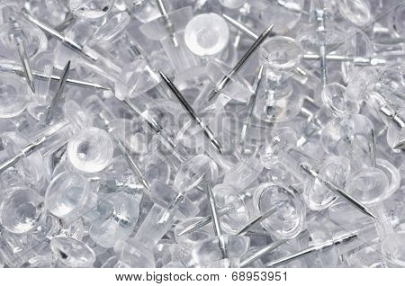 Heap of transparent thumbtacks