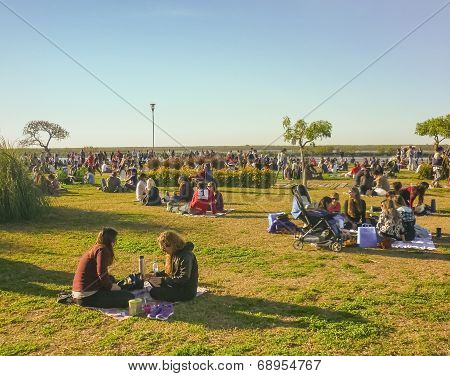 Crowd Of People Enjoying A Sunny Sunday At Park