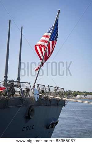 STATEN ISLAND, NY - MAY 25, 2014: The American flag flies from the stern of the guided-missile destroyer USS Cole (DDG 067) docked at Sullivans Piers during Fleet Week NY on May 25, 2014.