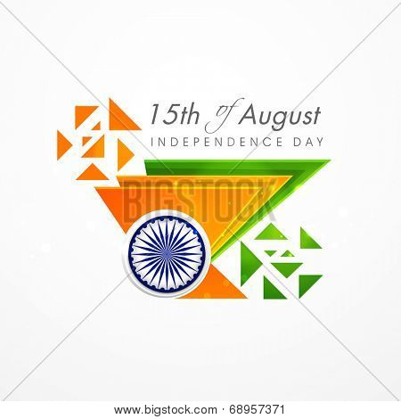 Creative concept for Indian Independence Day celebrations with triangles in national tricolors and Asoka Wheel on grey background.