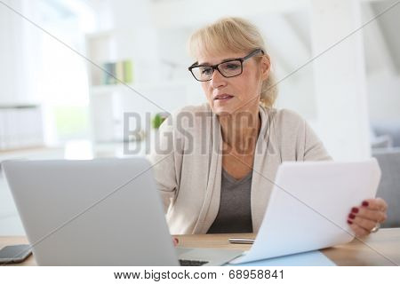 Senior woman working on laptop computer