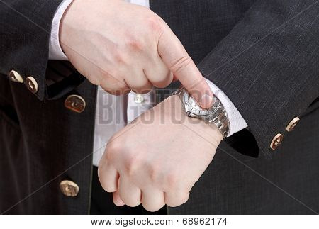 Man Show Exact Time On Wristwatch Close Up