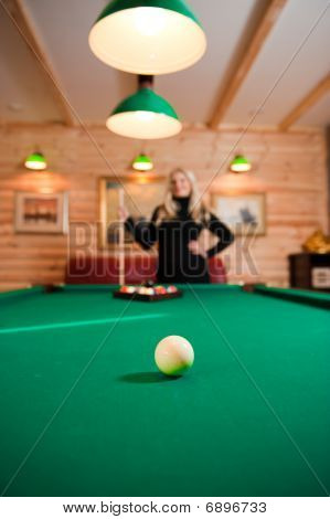 Young sexy woman with billiard balls
