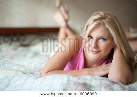 young sexy woman relaxing on  the bed