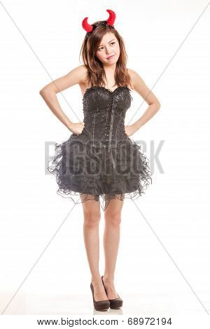 Chinese Woman In Black Dress And Devil Horns Standing With Hands On Waist Pouting