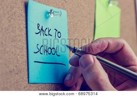 Man Writing A Memo - Back To School