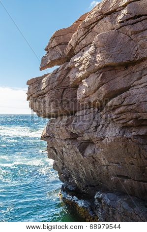 Rocky Cliffs Over Blue Sea