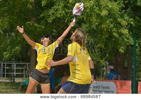 MOSCOW, RUSSIA - JULY 18, 2014: Mixed double of Brazil in the match against Cyprus during ITF Beach Tennis World Team Championship. Brazil won 3-0