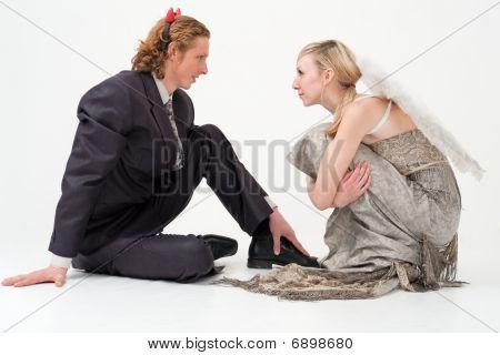 Angel And Devil Sitting