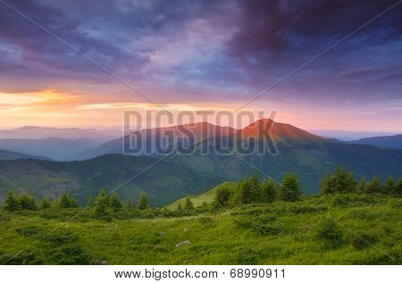 Summer landscape with colorful morning. The first rays of the sun on the mountain tops. Romanian Carpathians