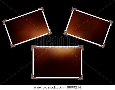 Three Photo Frames Isolated On Black With Texture