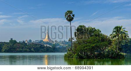 Panorama of  Shwedagon Pagoda over Kandawgyi Lake in Yangon, Burma (Myanmar)