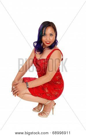 Crouching Asian Woman.