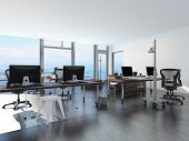 picture of movable  - Modern waterfront office overlooking the sea with several computer workstations on movable wheeled office tables in a bright airy room with a glass view window or wall - JPG