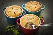 image of ground-beef  - Three homemade gourmet meat pies with fork in ground beef filling on rustic wood background - JPG