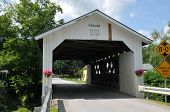 stock photo of covered bridge  - The Fuller Bridge or Black Falls covered bridge is located in Montgomery VT - JPG