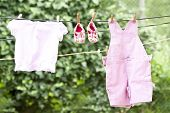 image of clotheslines  - Baby clothes hanging on the clothesline - JPG